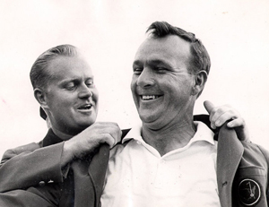 Arnold Palmer receiving his final green jacket from Jack Nicklaus in 1964. (Photo by augusta.com)