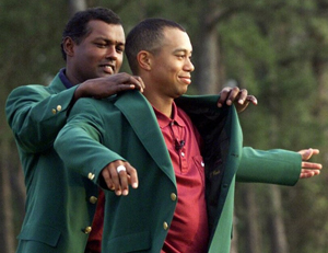 "Tiger Woods finishing his ""Tiger Slam"" in 2001. (Photo by Associated Press)"